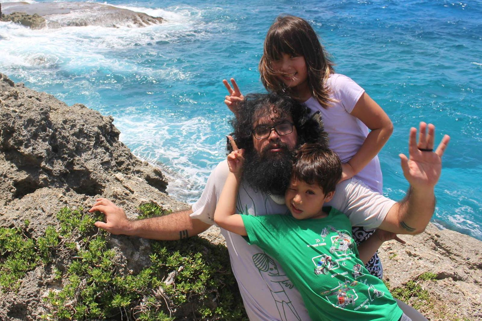 Dr. Michael Lujan Bevacqua and children on Guam