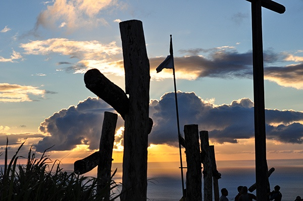 Beautiful sunset at the top of mount lam lam with a flag and crosses