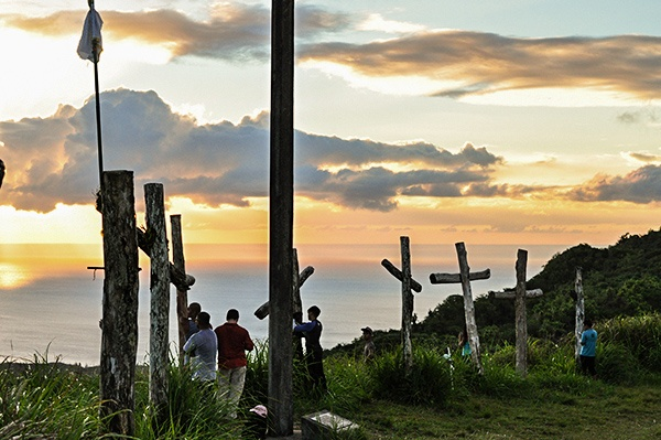 Crosses at the top of Mount Lamlam with sunset in the back