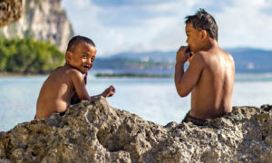 Kids play at Tanguisson Beach Park, Guam