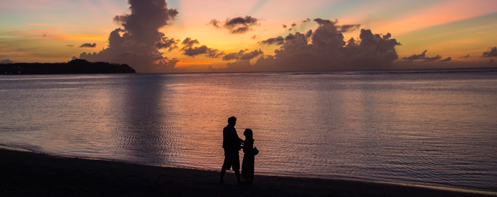 Couple on Tumon Bay, Guam at sunset