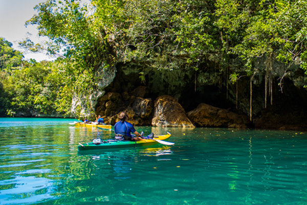 woman kayaking in Rock Islands, Palau