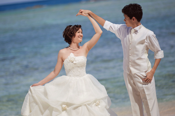 Japanese wedding couple on the beach, Guam