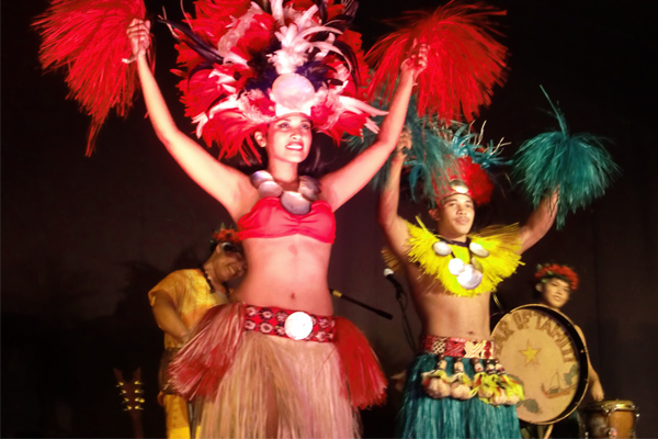 Male and female cultural dancers onstage