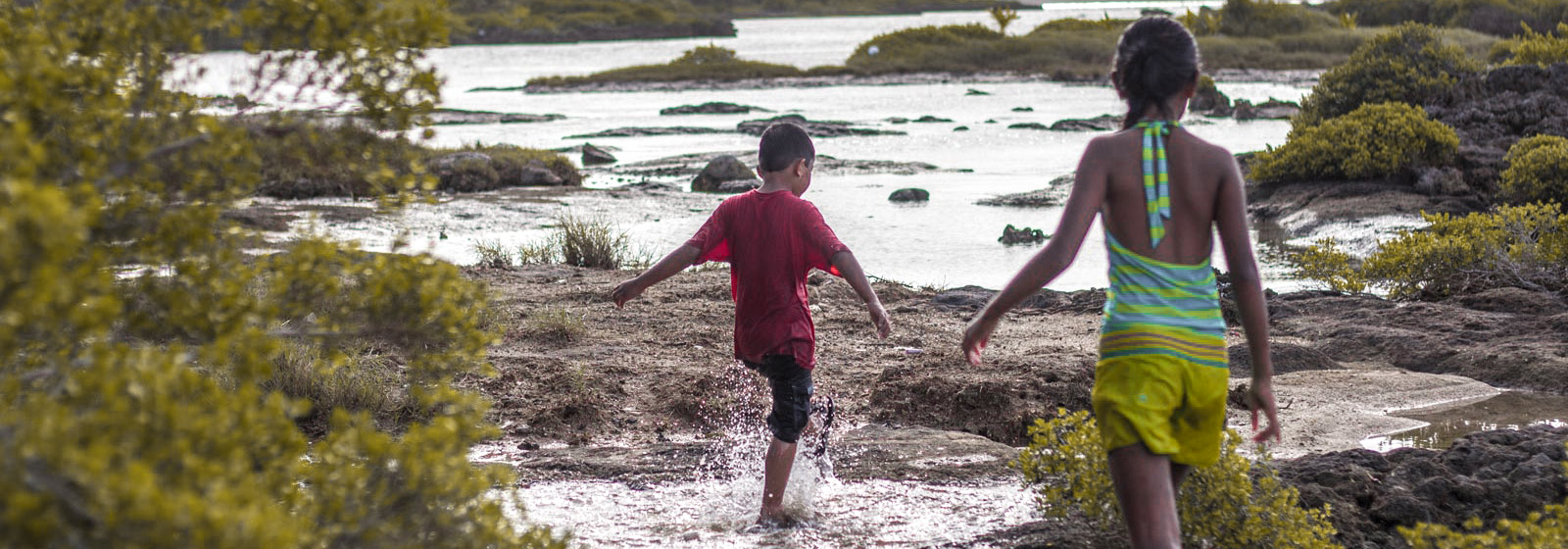 Guam children kids splashing in Inarajan Pools, Guam