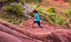 Running in red dirt hills on Guam
