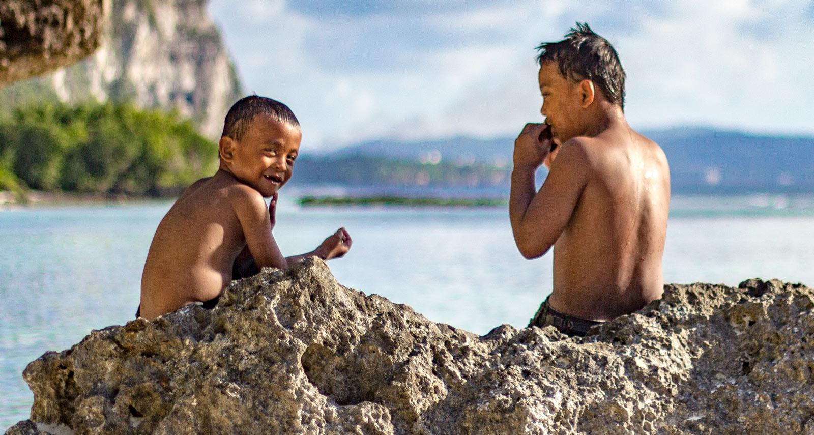 Kids play at Tanguisson Beach Park, Guam