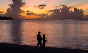 Couple on Tumon Bay, Guam at sunset
