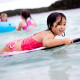 Little girl surfing on Guam